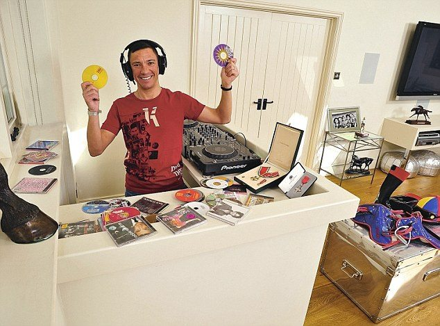 Frankie Dettori 'My Haven' his living room of his Newmarket home. 17.4.2012  His Items 1. His 'Disc Jockey' Turn tables 2. Bronze foot of 'Fujiyama Crest' last of the 7 winners at Ascot. 3.Frankie's fathers watch, his dad gave him for winning The Derby. 4. Picture of his kids. Leo,Ella,Mia,Tallulah & Rocco. 5. His M.B.E. and Italian Commandatore medals. 6. Boots, Saddles, whip & hat. 7.Picture of his 1st Prix De L'Arc De Triomphe winner 'Lammtara'