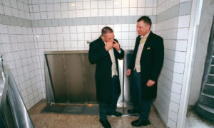 Mark & Kim take a quick snort of cocaine in the bogs outside Aarhus Cathedral, Denmark following their wedding.