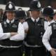 Police wear stupid hats