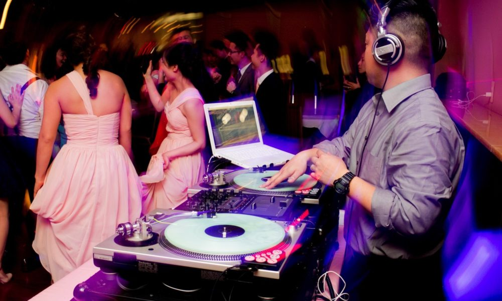 Guy playing tunes at Wedding thinks he's a dj